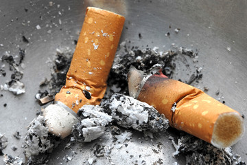 Cigarette butt in the ashtray,  unhealthy life style concept