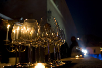 A set of wineglasses at a luxurious party in the night