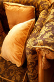 Orange pillows on a beautiful sofa in a modern bedroom poster