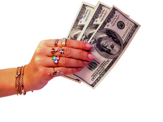 Dollars money in woman's hand with gold rings