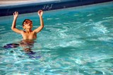 Boy With Orange Swm Goggles and Blue Swim Fins poster
