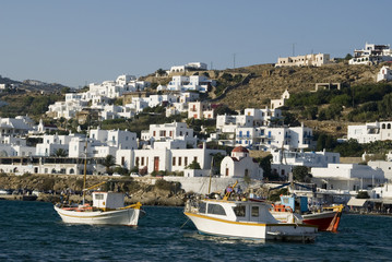 greek island harbor with fishing boats classic  arcthitecture