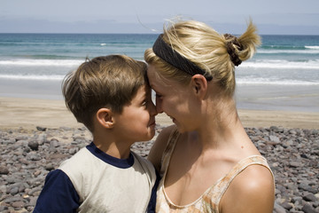 Smiling Boy and  happy mom in the beach