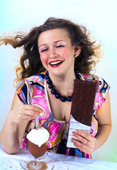 Laughing girl enjoying coffee drink and chocolate