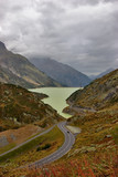 Bright lake and asphalt highway in Switzerland mountains. poster