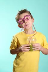 Enjoying a green health juice containing wheatgrass,