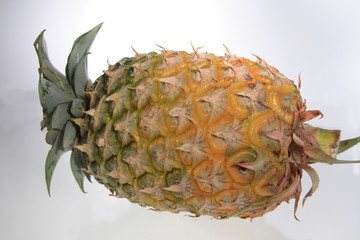 ripe   pineapple  with  yellow colour  on   white background