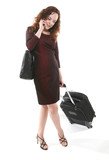 A pretty woman traveler with suitcase on the phone poster