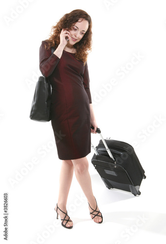 poster of A pretty woman traveler with suitcase on the phone