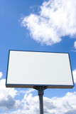 white billboard on blue sky with clouds poster