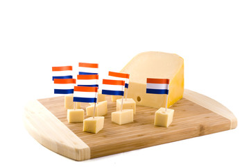 Dutch cheese cubes on a wooden board