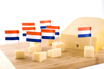 Dutch cubes from cheese on a wooden plate