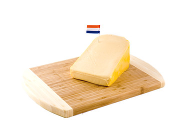 a big piece of Dutch cheese with a flag on it