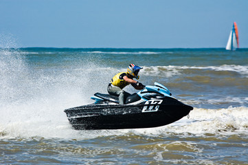 extreme  jet-ski watersports with big waves