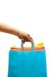 A woman carrying a bunch of shopping bags