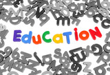 Colorful letters spelling out education over white poster