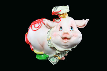 fancy piggy bank over black background