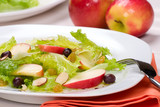 Fall salad with apples, almonds, raisins  and black olives poster