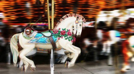 Image of a horse on a carousel in motion
