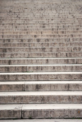 Long concrete stairway, focus on the bottom steps