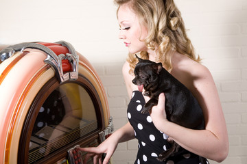 Pretty blond girl with chihuahua on her arm