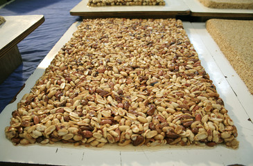 tray of caramelised peanuts in market