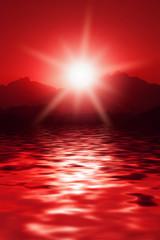Crimson sunrise in mountains