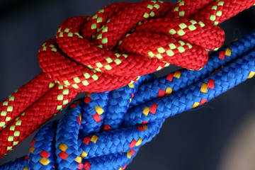 Two figure eight follow through knots in a climbing rope.