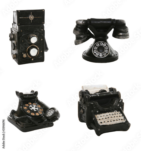 A antique, vintage typewriter, camera and phone