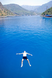 A man enjoying the turquoise waters of the Mediterrranean poster