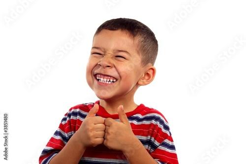 Leinwandbild Motiv Boy giving thumbs up and funny smile