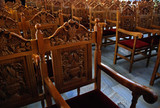 Church pews in order from a christian churchin Greece. poster
