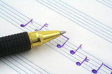 close-up of hand written music note and ballpoint pen tip poster
