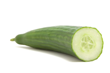 A fresh cut cucumber on white background.