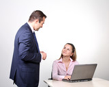 A male colleague offering a suggestion to a female coworker poster