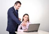 A male colleague offering a suggestion to a female coworker. poster