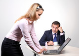 Businessman and female assistant working on laptop poster