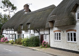 Row of Whitewashed and Timber Framed Thatched Village Cottages poster