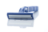Blue plastic razor with reflection isolated on white.  poster