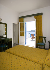 greek island hotel suite room with view of beach