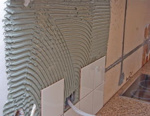 Tile glue or cement on the walls ready for mounting