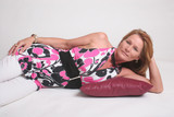 Pretty woman laying down on red pillow poster