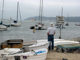 Man watching sailboats on bay