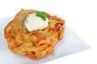 Potato pancake (latke), served with sour cream.