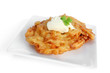 Potato pancake or latke, with sour cream