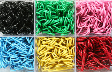 Box of colorful paperclips