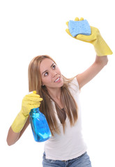 A pretty cleaning woman with a sponge over white
