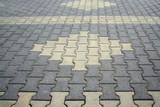 Fototapety Close-up of an aged brick paved courtyard