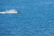 Jetski flying above the water