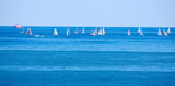 Cluster of racing sailboats on a Great Lake poster